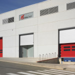 Galvanised steel Foldsystem doors in loading dock, combined with sectional door.