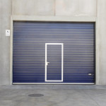 Sectional door RAL colour 5013, with pedestrian door.