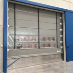 Foldsystem high-speed door in galvanised steel. Installed with a sliding fireproof door.