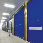 Stainless steel Quicksystem® doors for meat-curing warehouse.