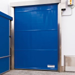 Stainless steel Quicksystem® doors to separate different rooms in the meat industry.